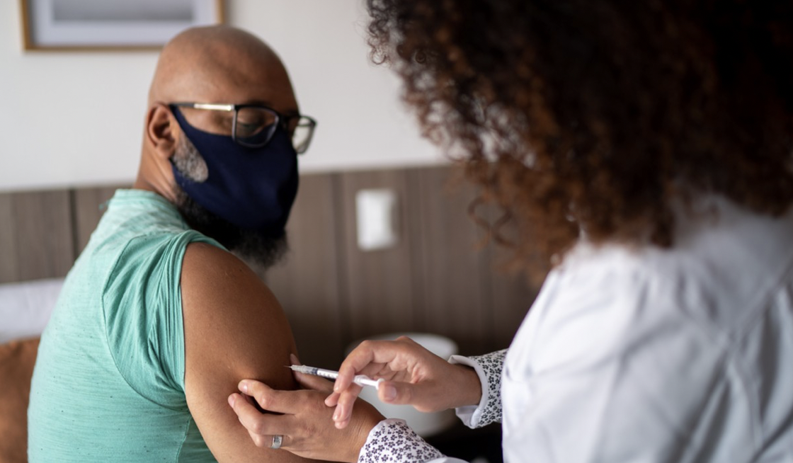 man receiving vaccine jab